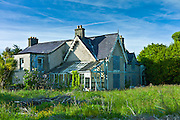 Abandoned derelict detached house awaiting renovation on Ocean Drive, Rosslare, Ireland
