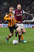 Hull City forward Jarrod Bowen (20) on the ball, closely watched by Aston Villa defender Alan Hutton (21)  during the EFL Sky Bet Championship match between Hull City and Aston Villa at the KCOM Stadium, Kingston upon Hull, England on 31 March 2018. Picture by Mick Atkins.