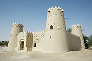 An ancient fort amidst date palms at Liwa Oasis.