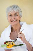 Portrait of senior woman eating healthily