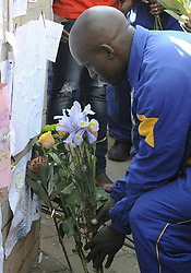 File Photo- Nelson Mandela Dead: Former South African President Has Died At 95. The former South African president had been suffering from a recurring lung infection, Thursday December 05, 2013.<br /> 59900846  <br /> A Police officer presents flowers to former South African president Nelson Mandela outside the hospital where Mandela is treated in Pretoria, South Africa, on June 25, 2013. South Africans on Monday were holding their breath over former President Nelson Mandela's health that has deteriorated from serious to critical. Mandela, 94, has been hospitalised for a recurring lung problem since June 8 2013. Pretoria, South Africa, on June 25, 2013. Picture by imago / i-Images<br /> UK ONLY