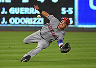 Cleveland Indians right fielder Brandon Guyer (6) makes a diving catch for the final out in the bottom of the fifth inning against the Kansas City Royals at Kauffman Stadium.