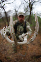 HUNTER WITH SHED WHITETAIL DEER ANTLER