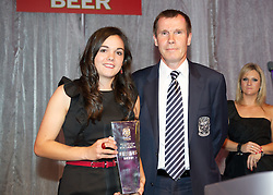 CARDIFF, WALES - Tuesday, October 4, 2011: Wales' Gwennan Harries accepts the Women's Player of the Year award on behalf of Jessica Fishlock from Jarmo Matikainen at the FAW Footballer of the Year Awards 2011 held at the Wales National Museum. (Pic by David Rawcliffe/Propaganda)