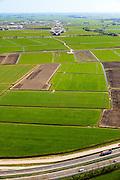 Nederland, Friesland, Leeuwarden, 01-05-2013; A31 gezien naar het zuiden, richting werkzaamheden aanleg N31 de Haak om Leeuwarden..De nieuwe rijksweg vormt de verbinding tussen de huidige A31 bij Marsum en de N31 bij Hemriksein (Wâldwei)..Motorway A31 near Leeuwarden, in the background the construction works of the new motorway . .luchtfoto (toeslag op standard tarieven).aerial photo (additional fee required).copyright foto/photo Siebe Swart