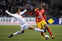 FOOTBALL - FRENCH CUP 2009/2010 - 1/16 FINAL - 10/02/2010 - RC LENS v OLYMPIQUE MARSEILLE - PHOTO JEAN MARIE HERVIO / DPPI - ABDOULRAZAK BOUKARI (RCL) / HILTON (OM)