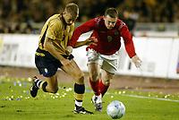 Fotball, 31. mars 2004, Privatlandskamp, Sverige-England 1-0, Wayne Rooney, England og Olof Mellberg, Sverige
