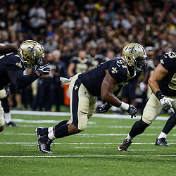 Aug 26, 2017; New Orleans, LA, USA; New Orleans Saints linebacker Hau'oli Kikaha (44) and defensive end Alex Okafor (57) and linebacker A.J. Klein (53) against the Houston Texans during the first quarter of a preseason game at the Mercedes-Benz Superdome. Mandatory Credit: Derick E. Hingle-USA TODAY Sports