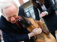 U.S. Senator Joe Lieberman (D-CT) has his face licked by a dog outside a polling place in Milford, Connecticut November 7, 2006.  REUTERS/Andrew Gombert  (UNITED STATES)<br />