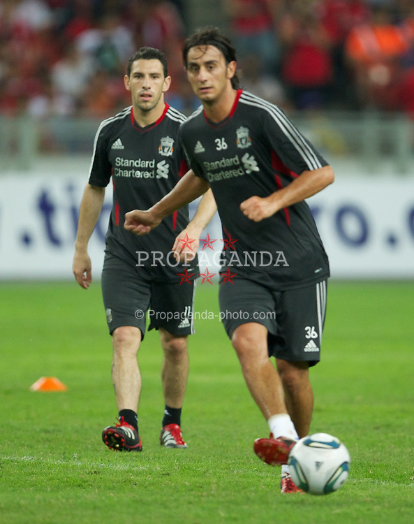 KUALA LUMPUR, MALAYSIA - Thursday, July 14, 2011: Liverpool's Alberto Aquilani and Maximiliano Ruben Maxi Rodriguez during a training session at the National Stadium Bukit Jalil in Kuala Lumpur ahead of their second pre-season friendly match on day four of the club's Asia Tour. (Photo by David Rawcliffe/Propaganda)