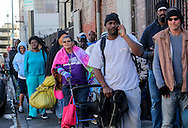 People line for Thanksgiving meal on Wednesday November 25, 2015, in Los Angeles. Thousands of Skid Row residents and homeless people from downtown and beyond were served Thanksgiving dinners during the Los Angeles Mission's annual holiday feast. (Photo by Ringo Chiu/PHOTOFORMULA.com)<br /> <br /> Usage Notes: This content is intended for editorial use only. For other uses, additional clearances may be required.