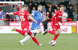 Peterborough United's Grant McCann in action with Crawley Town's Dannie Bulman - Photo mandatory by-line: Joe Dent/JMP - Tel: Mobile: 07966 386802 01/03/2014 - SPORT - FOOTBALL - Crawley - Broadfield Stadium - Crawley Town v Peterborough United - Sky Bet League One
