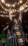 Kimberly Rogers wave after receiving her diploma at the Ohio University 2001 Commencement