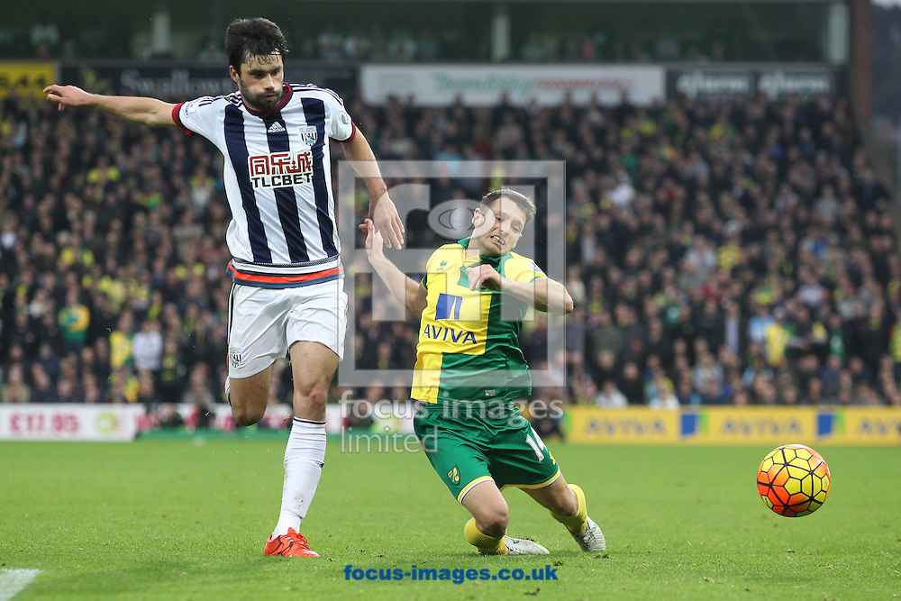 Wes Hoolahan of Norwich and Claudio Yacob of West Bromwich Albion in action during the Barclays Premier League match at Carrow Road, Norwich<br /> Picture by Paul Chesterton/Focus Images Ltd +44 7904 640267<br /> 24/10/2015