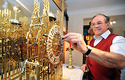 "©London News pictures...28/10/2010.  Michael Tooke changes the time on striking skeleton clock (circa 1850) designed to look like York Minster. Staff at Horological Workshops start the task of changing the 100's of clocks at their store in Guildford, Surrey, UK. Micahel Tooke who has owned the store for 43 years and worked in the clock business all his life said. ""at this time of year we get alot of people who bring clocks in for repair after they have changed the time incorreectly by winding back the hands manually"""