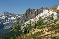 Two adult females day hiking along Pacific Crest trail near Cutthroat Pass. North Cascades Washington