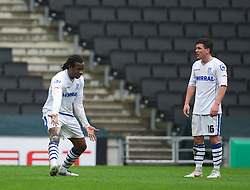 MILTON KEYNES, ENGLAND - Easter Monday, April 9, 2012: Tranmere Rovers' Ian Goodison and David Buchanan argue after Milton Keynes Dons score the second goal during the Football League One match at the Stadium MK. (Pic by David Rawcliffe/Propaganda)