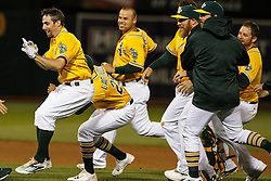 OAKLAND, CA - JUNE 17:  Billy Burns #1 of the Oakland Athletics is congratulated by teammates after hitting a walk off single against the Los Angeles Angels of Anaheim after the game at the Oakland Coliseum on June 17, 2016 in Oakland, California. The Oakland Athletics defeated the Los Angeles Angels of Anaheim 3-2. (Photo by Jason O. Watson/Getty Images) *** Local Caption *** Billy Burns