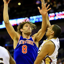 Mar 28, 2016; New Orleans, LA, USA; New York Knicks center Robin Lopez (8) shoots over New Orleans Pelicans center Alexis Ajinca (42) during the second quarter of a game at the Smoothie King Center. Mandatory Credit: Derick E. Hingle-USA TODAY Sports