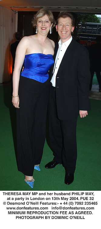 THERESA MAY MP and her husband PHILIP MAY,  at a party in London on 13th May 2004.PUE 32