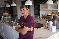LEXINGTON, Ky., -- Nate Polly owner of Nate's Coffee a small batch coffee roaster serving central Kentucky coffee shops,  and restaurants with his team's blends, Monday, Sept. 25, 2017 at the Nate's Coffee in LEXINGTON.