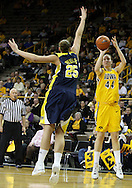 26 JANUARY 2009: Iowa center Megan Skouby (44) puts up a shot over Michigan center Krista Phillips (25) during the first half of an NCAA women's college basketball game Monday, Jan. 26, 2009, at Carver-Hawkeye Arena in Iowa City, Iowa. Iowa defeated Michigan 77-69.
