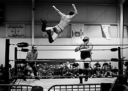 Tracer X gives a high-flying performance as he leaps off the ropes against Josh Powers during Old School Championship Wrestling Sunday, March 13, 2016 at the Hanahan Sports Complex. Paul Zoeller/Staff