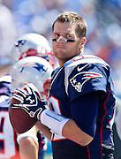 NASHVILLE, TN - SEPTEMBER 9:  Tom Brady #12 of the New England Patriots warms up on the sidelines during the season opener against the Tennessee Titans at LP Field on September 8, 2012 in Nashville, Tennessee.  The Patriots defeated the Titans 34 to 13.  (Photo by Wesley Hitt/Getty Images) *** Local Caption *** Tom Brady Sports photography by Wesley Hitt photography with images from the NFL, NCAA and Arkansas Razorbacks.  Hitt photography in based in Fayetteville, Arkansas where he shoots Commercial Photography, Editorial Photography, Advertising Photography, Stock Photography and People Photography