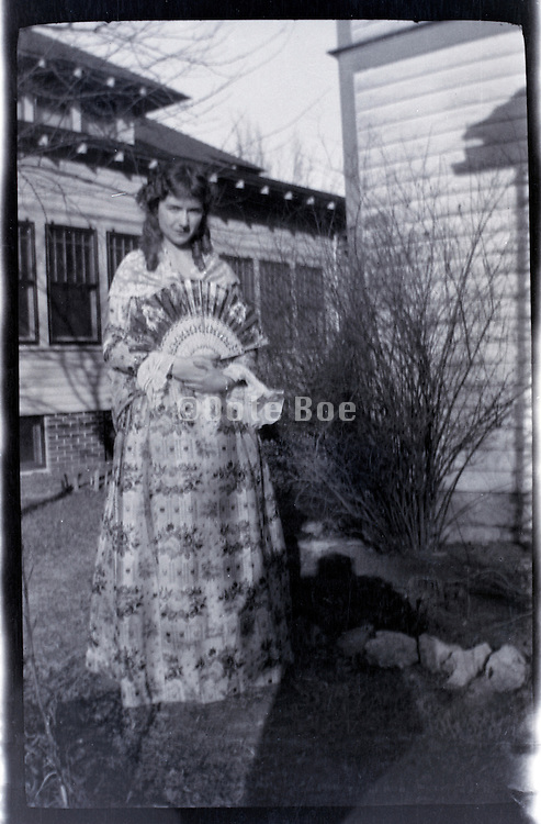 fashionable dressed young adult woman posing by house rural USA 1920s 1930s