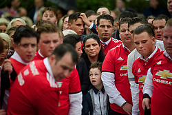 © Licensed to London News Pictures. 26/10/2017. Epsom, UK. Family members and mourners wearing  Manchester United clothing at the graveside at the funeral of Tom 'Tomboy' Doherty the nephew of Big Fat Gypsy Weddings star Paddy Doherty, at Epsom Cemetery in Epsom, Surrey. Tom Doherty was 17 when he was killed in a car crash in South Nutfield in Surrey on October 9. He had passed his driving test just days earlier. Photo credit: Ben Cawthra/LNP