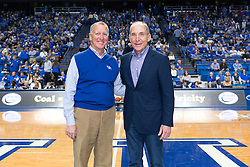 Keeneland President Bill Thomasson, left, and UK President Eli Capilouto during halftime of the University of Kentucky versus the LSU Tigers, Saturday, March 05, 2016 at Rupp Arena in Lexington .
