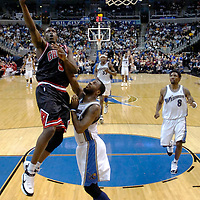 19 December 2007:   Chicago Bulls forward Luol Deng (9) scores 2 of his 20 points in the second half on a drive to the basket against Washington Wizards guard DeShawn Stevenson (2) at the Verizon Center in Washington, D.C.  The Bulls defeated the Wizards 95-84.
