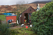Father-in-law working at Sarah Leggitt's estate cottage, a former Smithy with livestock at Lochbuie, Isle of Mull, Scotland.