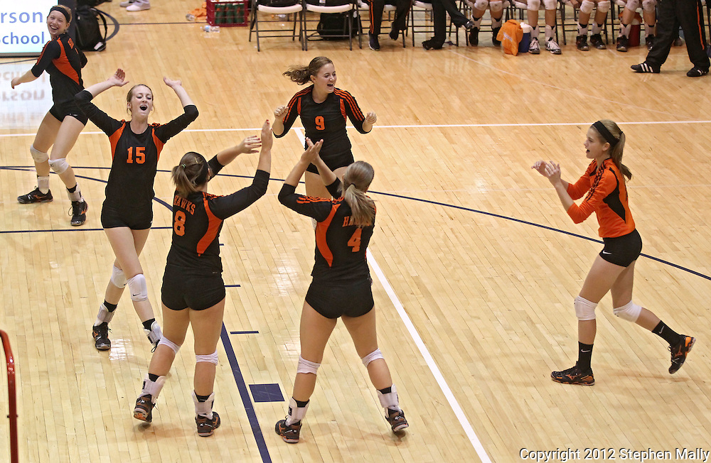 West Delaware's Emily Thole (7), Leslie Hoffmann (15), Haley Morrison (8), Maddie Coates (9), Cassie Vaske (4), and Reeann McCarty (10) celebrate a score during their game against Dike-New Hartford at the Westside Volleyball Invitational at Jefferson High School in Cedar Rapids on Saturday October 6, 2012. Dike-New Hartford defeated West Delaware 25-13 and 25-23.