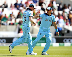 England's Ben Stokes (left) celebrates after taking the catch of Afghanistan's Gulbadin Naib during the ICC Cricket World Cup Warm up match at The Oval, London.