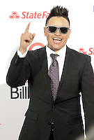(CH) fl-el-billboard-latin-music-awards-CH25 --Elvis Crespo arrives at the Billboard Latin Music Awards 2012 at Bank United Center on April 26, 2012 in Miami, Florida Staff photo/Cristobal Herrera