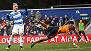Queens Park Rangers forward Sebastian Polter and Wolverhampton Wanderers defender Danny Batth watch the ball head towards goal during the Sky Bet Championship match between Queens Park Rangers and Wolverhampton Wanderers at the Loftus Road Stadium, London, England on 23 January 2016. Photo by Andy Walter.
