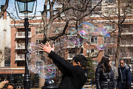 Kids playing with giant bubbles, Washington Square Park, New York City