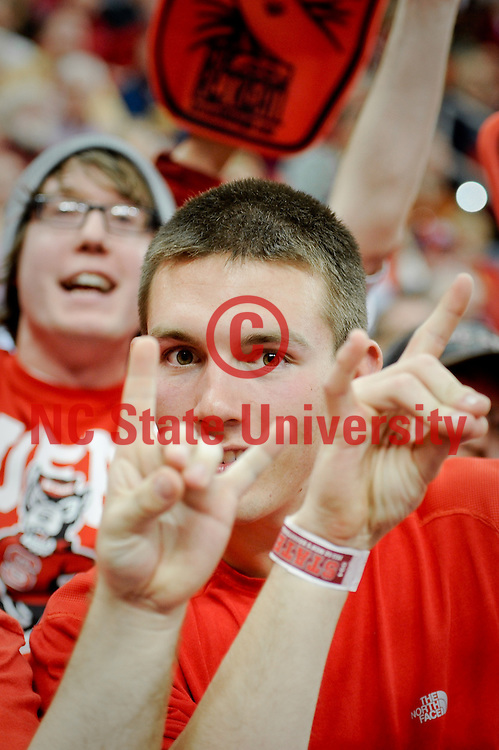 NCSU students show their Wolfpack pride during the men's basketball game against Boston College. Photo by Becky Kirkland.