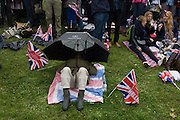 Exhausted from the long day's wait, the great British public brave bad weather to celebrate the Queen's Diamond Jubilee flotilla on the river Thames. 1,000 boats made their way past Battersea Park, London including their reigning monarch of 60 years and other members of the royal family during a weekend of official festivities and street parties.