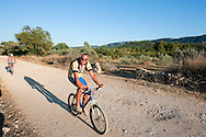 Cyclists on Stari Grad Plain, a UNESCO World Heritage Site on the island of Hvar, Croatia