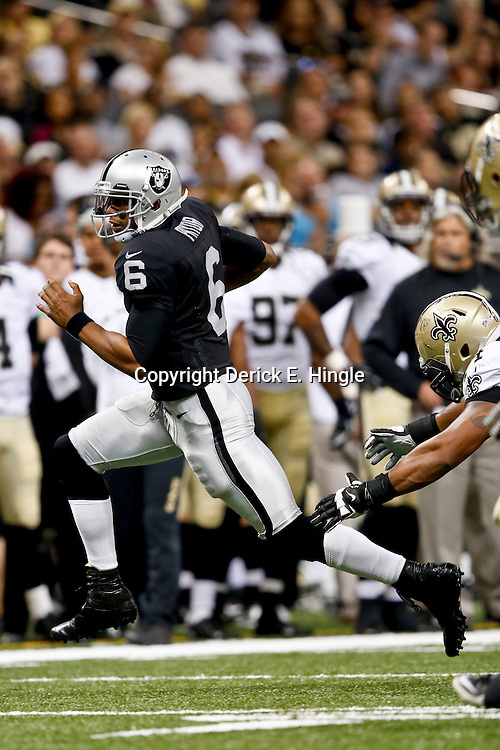 Aug 16, 2013; New Orleans, LA, USA; Oakland Raiders quarterback Terrelle Pryor (6) runs against the New Orleans Saints during the second half of a preseason game at the Mercedes-Benz Superdome. The Saints defeated the Raiders 28-20. Mandatory Credit: Derick E. Hingle-USA TODAY Sports