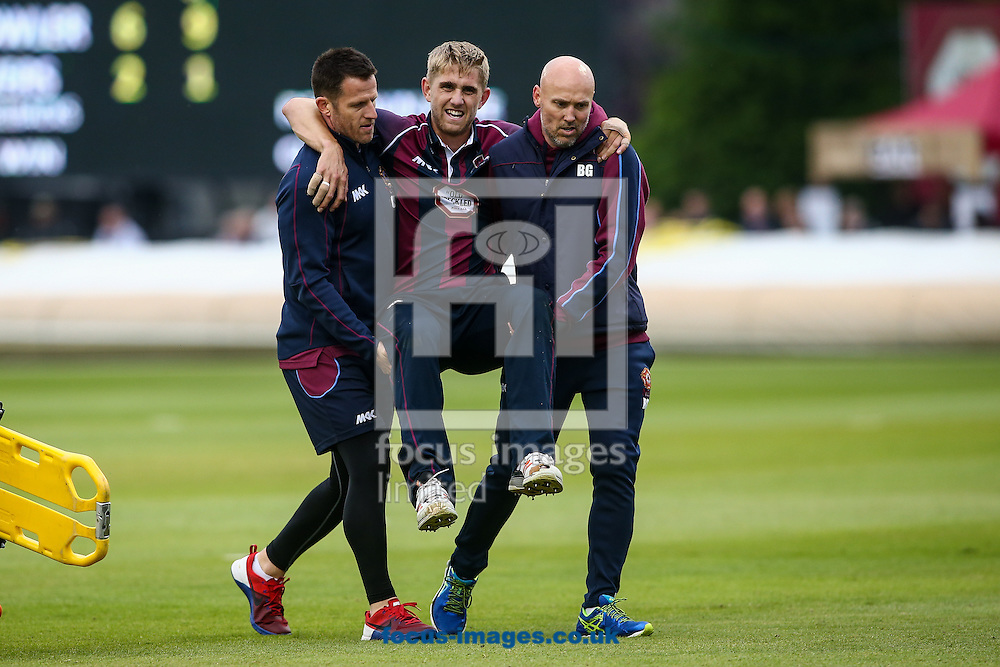 Olly Stone of Northants Steelbacks (centre) is carried from the field after breaking down whilst bowling during the Natwest T20 Blast match at the County Ground, Northampton<br /> Picture by Andy Kearns/Focus Images Ltd 0781 864 4264<br /> 03/06/2016