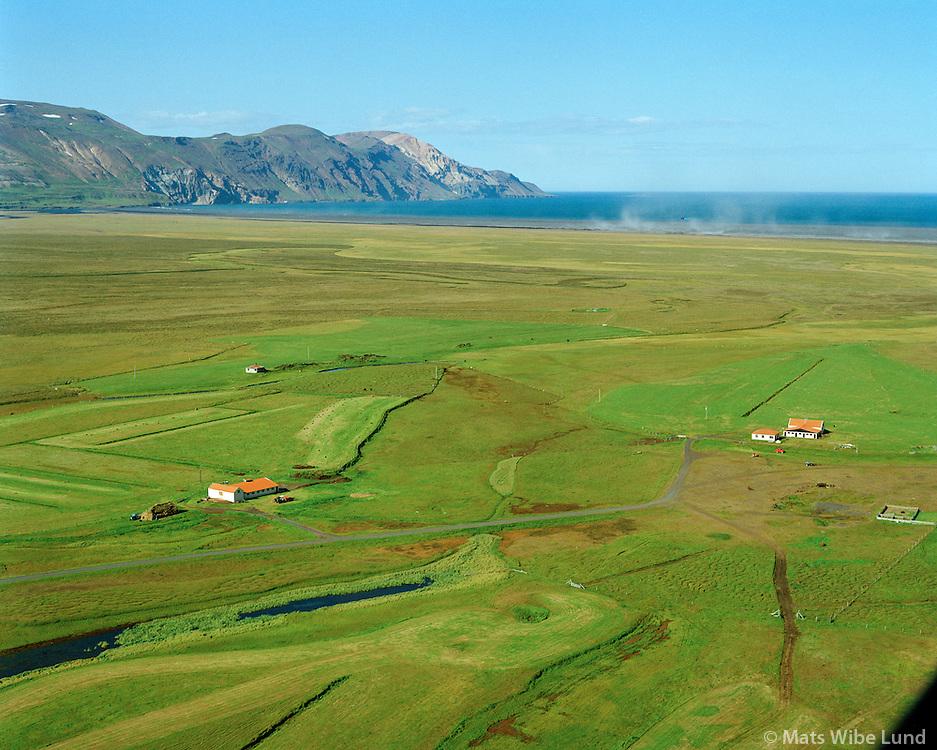 """Hólmatunga og Eyjasel séð til norðurs, Héraðsandur í bakgrunni. Fljótsdalshérað áður Hlíðarhreppur / Holmatunga and Eyjasel viewing north, Heradssandur beach """"blowing up"""" in background, Fljotsdalsherad former Hlidarhreppur."""