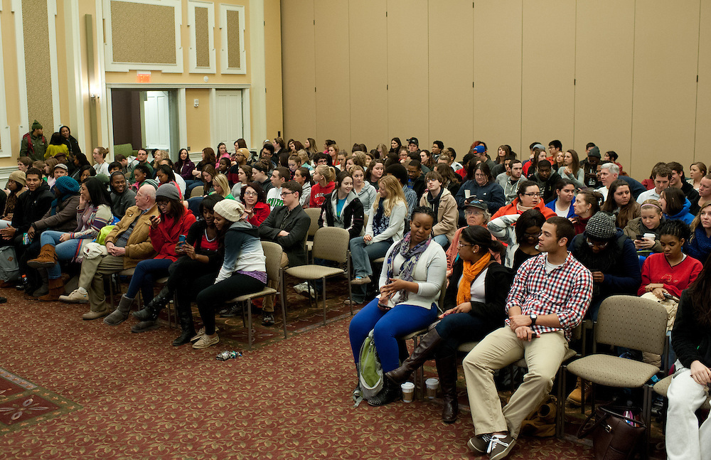 """Students fill the seats of Baker Ballroom before Daryl Davis speaks about his experiences with the Ku Klux Klan Thursday, February 21, 2013. Davis is the author of """"Klan-Destine Relationships,"""" a nonfiction account of his journeys while infiltrating the minds of KKK members."""