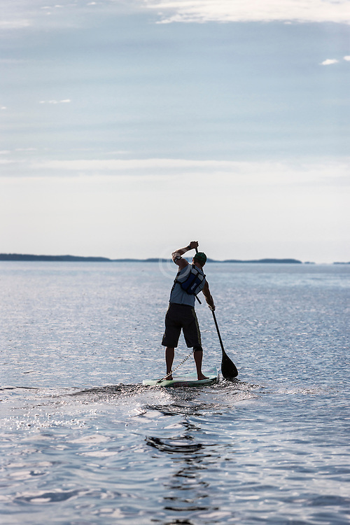 Thor Emory paddleboarding in Penobscot Bay of the North Atlantic Ocean, training for race