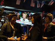 "02 MARCH 2016 - BANGKOK, THAILAND: Hillary Clinton, Democratic candidate for the US Presidency appears on TV in the US during an election watch event on ""Super Tuesday"" sponsored by the US Embassy at Dean & Delucca in Bangkok.   PHOTO BY JACK KURTZ"