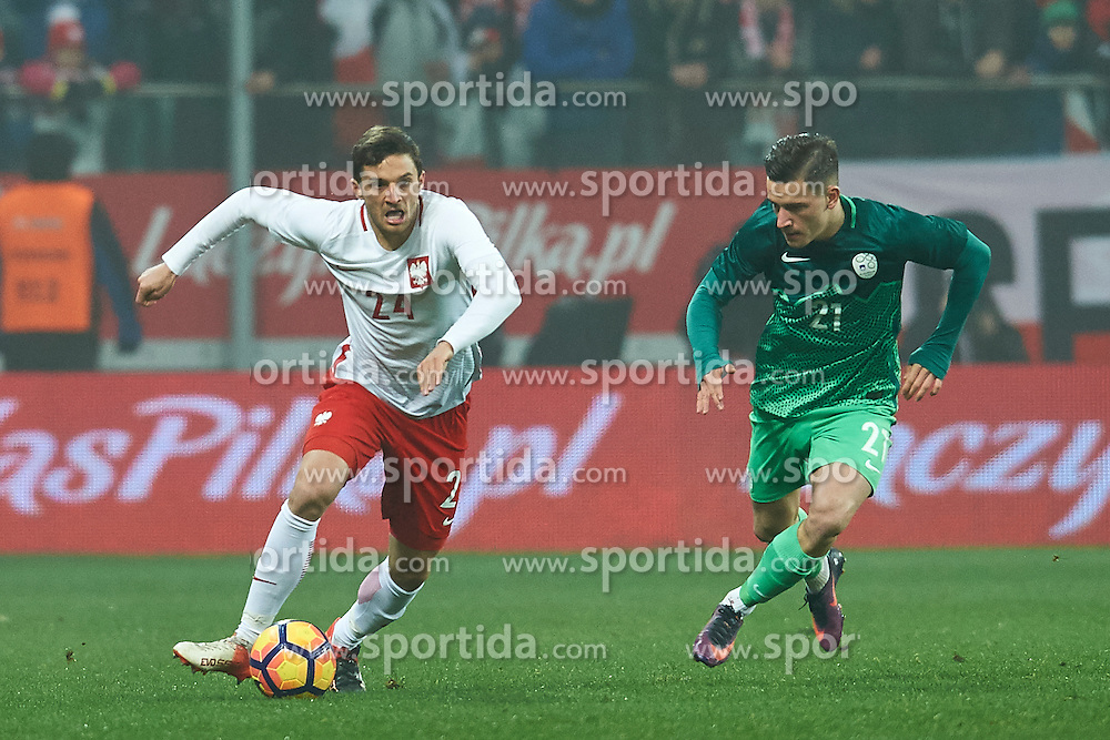 Wroclaw, Poland - 2016 November 14: (L) Bartosz Bereszynski of Poland fights for the ball with (R) Benjamin Verbic of Slovenia during Poland v Slovenia - International Friendly Soccer Match at Municipal Stadium on November 14, 2016 in Wroclaw, Poland.<br /> <br /> Adam Nurkiewicz declares that he has no rights to the image of people at the photographs of his authorship.<br /> <br /> Picture also available in RAW (NEF) or TIFF format on special request.<br /> <br /> Any editorial, commercial or promotional use requires written permission from the author of image.<br /> <br /> Mandatory credit:<br /> Photo by © Adam Nurkiewicz / Mediasport