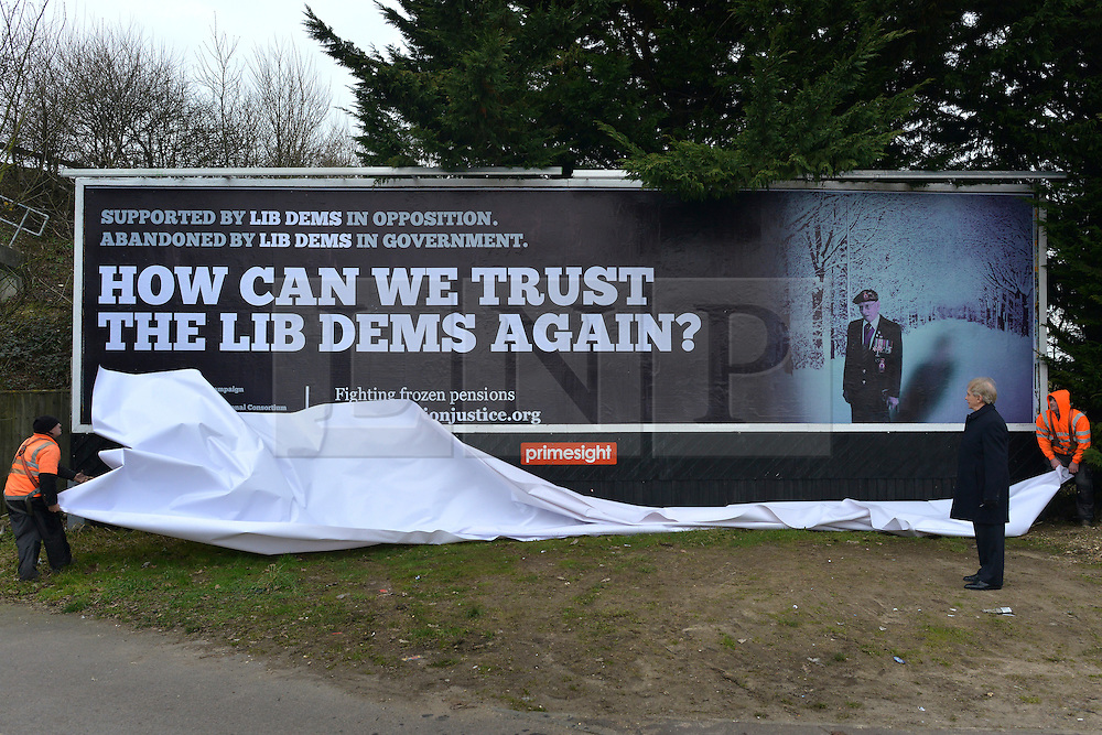 "© Licensed to London News Pictures. 25/02/2013. Eastleigh, UK. Brian Leggett, UK spokesperson for the International Consortium of British Pensioners  (ICBP) launches a billboard campaign in Eastleigh, Hampshire, today 25th February 2013. the ""How Can We Trust The Lib Dems Again"" claims that pensioners who live abroad are unlikely to receive their full state pensions. Photo credit : Stephen Simpson/LNP"