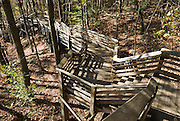 Near Fayetteville, West Virginia, stairs and boardwalk descend from Canyon Rim Visitor Center to a viewpoint for the New River Gorge Bridge, a high steel-arch bridge within the boundaries of New River Gorge National River. The New River Gorge National River is a unit of the United States National Park Service designed to protect and maintain the New River Gorge in southern West Virginia, USA. Established in 1978, the area stretches for 53 miles (85 km) from just downstream of Hinton to Hawks Nest State Park near Ansted. The New River Gorge Bridge, a part of US Highway 19, is a steel-arch bridge, in Fayetteville, West Virginia. With a length of 3030 feet (924 m), it was for many years the longest in the world of that type. Its arch extends 1700 feet (518 m).